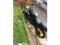 Suzuki GSX F 600 Matt black motorbike with yellow wheels