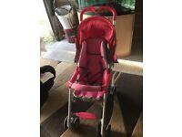 Pink pram with rain over in gc nearly new for age 2 to 3 years old not used that many times