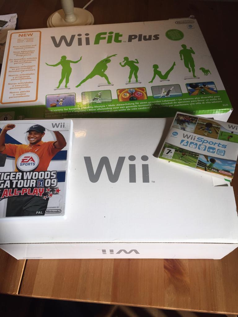 Wii bundle including wii fit plus and game