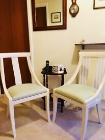 A pair of solid wood elegant chairs.