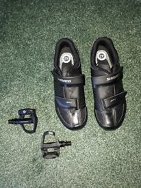 Shimano road cycling shoes size 8 and Boardman pedals.