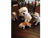 Four dog ornaments
