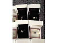 Genuine pandora charms silver and gold