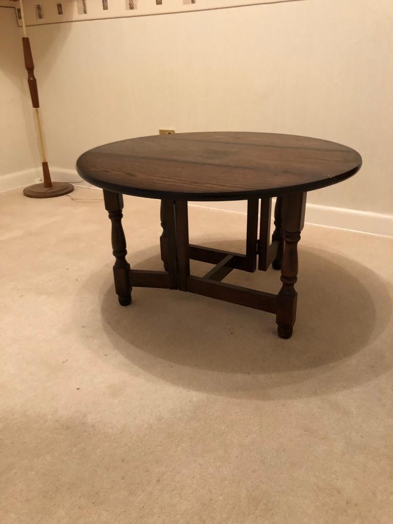 Dark wood round card table