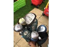 Job lot of golf clubs and bag
