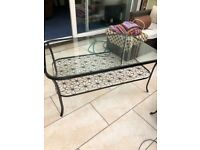 Glass and metal coffee table from Ikea. Flower design . Lovely sturdy coffee table