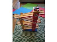 Wooden toy car race track tower
