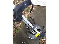 black three wheel folding golfing cart