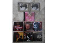 eight rod stewart and U2 cds used