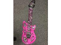 Pink blow-up guitar