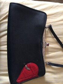 Black leather kitsch rockabilly handbag with lovely red heart pocket and catch details.