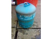 2 different gas bottles bbq gas and camping gaz