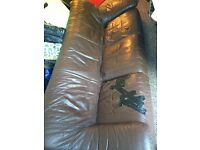 Brown 3 seater leather sofa. few slits in seat area. FREE