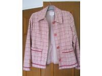 Next, pink check jacket with trim and pockets age 11-12