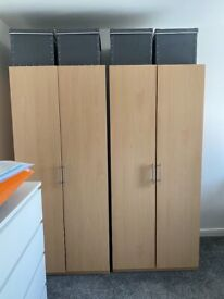 Two wardrobes beech colour with rail and shelf