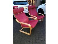 Two red ikea chairs