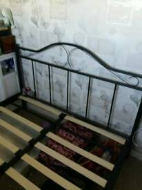 Black metal double bed
