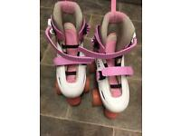 Quadracing pink and white roller skates, adjustable to fit size 12-2
