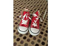 Baby red converse trainers