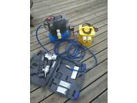 Air compressor and portable power transformer converter
