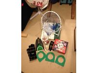 50 Golf Balls, chipping net, return putter, golf towel, tees, glove & divet tool