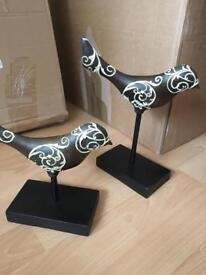 Pair of black and gold decorative birds