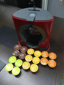 A Dolce Gusto coffee pod machine with pods as seen in pics