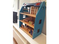Wooden dolls house with some furniture