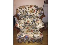 Two floral wooden framed chairs