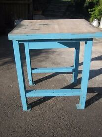 Workbench/industrial table. Metal legs, solid wood top. Height can be adjusted.