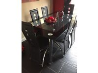 Black and chrome glass Dining table and 6 chairs