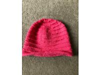 Hand knitted pink girls pull on hat size large or women's size small