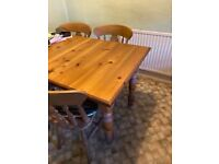 Pine extending kitchen table and 4 chairs.