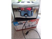 Breville 4 Slice Stainless Steel Toaster. In good condition.