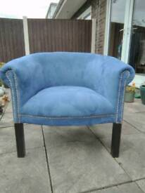 Modern dusky blue tub chair.