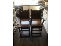 Old Oak dining chairs 2 carvers and 4 normal done in the 16th century style.
