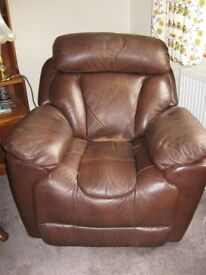 Brown leather electric recliner arm chair .