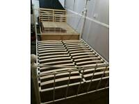 Cream kingsize metal bed