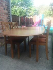 Wooden extending dining table and chairs