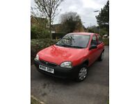 Red Vauxhall Corsa 2000 plate