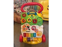 Vtech baby walker (see pic/internet). Good condition but missing a small play phone & door.