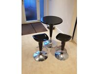 Like new bar table and stools black and silver