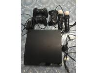PS3 slim 320gb with camera move and 18 games