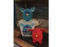 2 furby's 1 blue (with box) and 1 orange/red