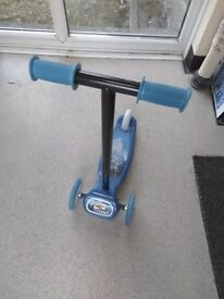 Blue three wheel scooter