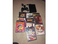 Slim Sony ps2 console and games