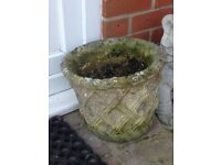 Two matching solid stone round planters
