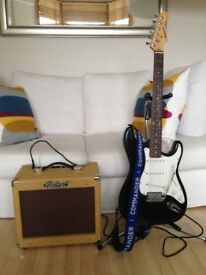 Electric guitar, leads and amp