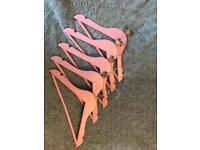 Pink wooden children's hangers