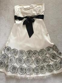 Warehouse dress, satin and fully lined with black beaded detailing to trim. Size 14